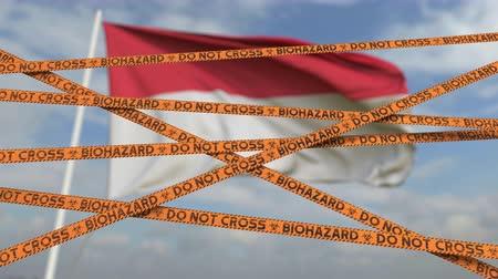 sınırları : Do not cross biohazard tape lines on the Indonesian flag background. Restricted entry or quarantine in Indonesia. Conceptual looping 3D animation Stok Video