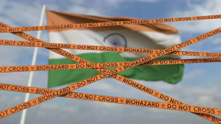 figyelmeztető jel : Caution biohazard tape with flag of India as a background. Indian restricted entry or quarantine. Conceptual looping 3D animation Stock mozgókép