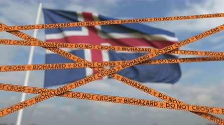 níveis : Do not cross biohazard tape lines on the Icelandic flag background. Restricted entry or quarantine in Iceland. Conceptual looping 3D animation Stock Footage