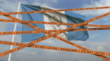 níveis : Caution biohazard tape with flag of Guatemala as a background. Guatemalan restricted entry or quarantine. Conceptual looping 3D animation