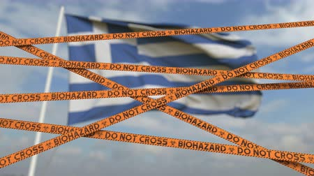 teszi : Do not cross biohazard tape lines on the Greek flag background. Restricted entry or quarantine in Greece. Conceptual looping 3D animation Stock mozgókép