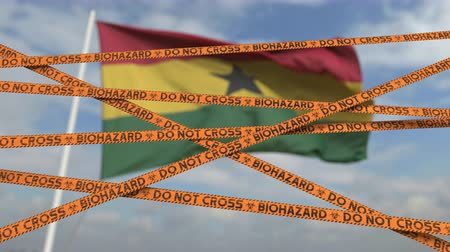 scoppio : Biohazard restriction tape lines against the Ghanaian flag. Restricted entry or quarantine in Ghana. Conceptual looping 3D animation