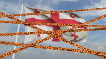 barriers : Biohazard restriction tape lines against the Georgian flag. Restricted entry or quarantine in Georgia. Conceptual looping 3D animation