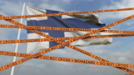 finland : Biohazard restriction tape lines against the Finnish flag. Restricted entry or quarantine in Finland. Conceptual looping 3D animation