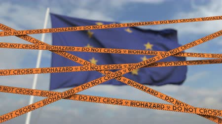 níveis : Caution biohazard tape with flag of the EU as a background. European restricted entry or quarantine. Conceptual looping 3D animation