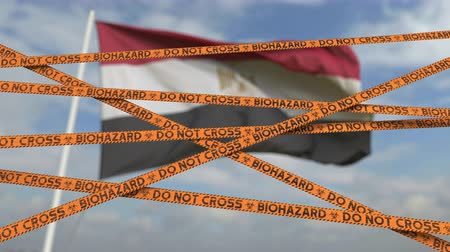 kapalı : Biohazard restriction tape lines against the Egyptian flag. Restricted entry or quarantine in Egypt. Conceptual looping 3D animation