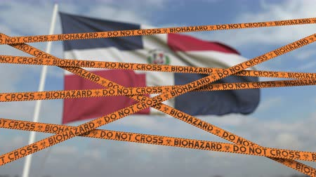 figyelmeztető jel : Do not cross biohazard tape lines on the Dominican flag background. Restricted entry or quarantine in the Dominican Republic. Conceptual looping 3D animation