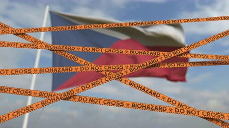 tcheco : Biohazard restriction tape lines against the Czech flag. Restricted entry or quarantine in the Czech Republic. Conceptual looping 3D animation