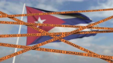 níveis : Biohazard restriction tape lines against the Cuban flag. Restricted entry or quarantine in Cuba. Conceptual looping 3D animation