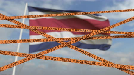 sınırları : Caution biohazard tape with flag of Costa Rica as a background. Costa Rican restricted entry or quarantine. Conceptual looping 3D animation Stok Video