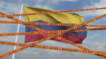 níveis : Do not cross biohazard tape lines on the Colombian flag background. Restricted entry or quarantine in Colombia. Conceptual looping 3D animation
