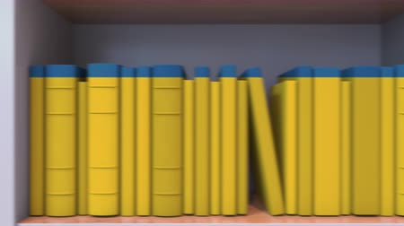 livraria : Many spines of the books form the Swedish flag. Education or science in Sweden Stock Footage
