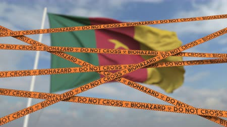 しない : Do not cross biohazard tape lines on the Cameroonian flag background. Restricted entry or quarantine in Cameroon. Conceptual looping 3D animation