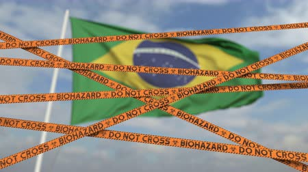 brezilya : Do not cross biohazard tape lines on the Brazilian flag background. Restricted entry or quarantine in Brazil. Conceptual looping 3D animation