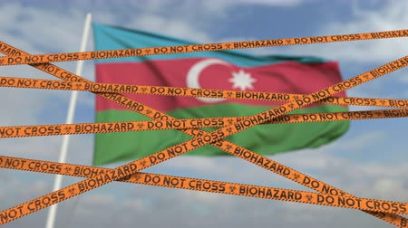 epidemy : Biohazard restriction tape lines against the Azerbaijani flag. Restricted entry or quarantine in Azerbaijan. Conceptual looping 3D animation Stock Footage
