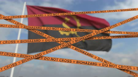 zakaz : Do not cross biohazard tape lines on the Angolan flag background. Restricted entry or quarantine in Angola. Conceptual looping 3D animation