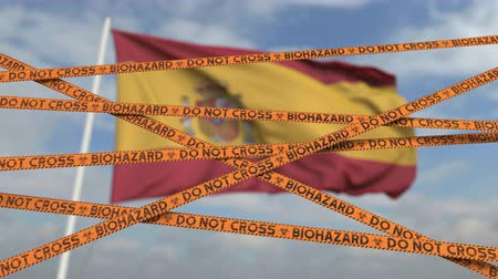 border crossing : Caution biohazard tape with flag of Spain as a background. Spanish restricted border crossing or quarantine. Conceptual looping 3D animation