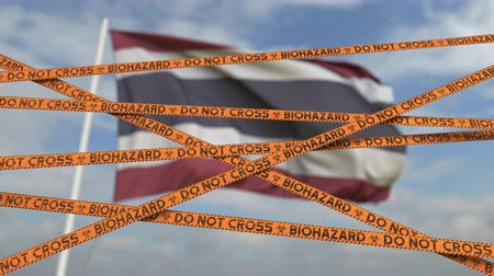 border crossing : Biohazard restriction tape lines against the Thai flag. Restricted border crossing or quarantine in Thailand. Conceptual looping 3D animation