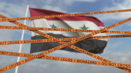 teszi : Do not cross biohazard tape lines on the Syrian flag background. Restricted border crossing or quarantine in Syria. Conceptual looping 3D animation Stock mozgókép
