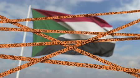 korlátozás : Do not cross biohazard tape lines on the Sudanian flag background. Restricted border crossing or quarantine in Sudan. Conceptual looping 3D animation