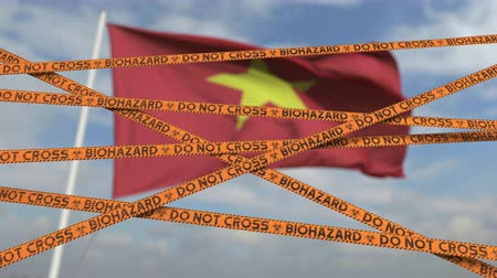 barriers : Biohazard restriction tape lines against the Vietnamese flag. Restricted entry or quarantine in Vietnam. Conceptual looping 3D animation Stock Footage
