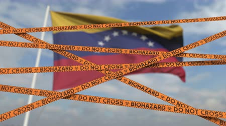 slagboom : Biohazard restriction tape lines against the Venezuelan flag. Restricted entry or quarantine in Venezuela. Conceptual looping 3D animation