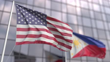 bandeira americana : Waving flags of the USA and the Philippines in front of a modern skyscraper Vídeos