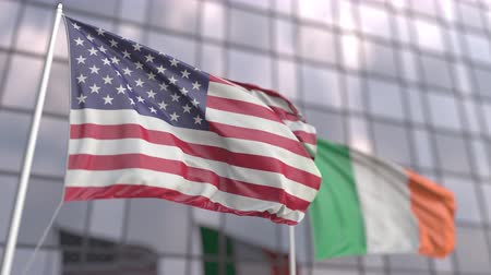 meeting negotiate : Waving flags of the USA and Ireland in front of a modern building Stock Footage