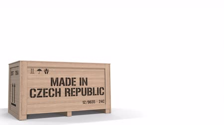 tcheco : Crate with MADE IN CZECH REPUBLIC text isolated on light background. industrial production related 3D animation Stock Footage
