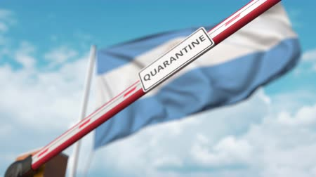 epidemy : Closed boom gate with QUARANTINE sign on the Argentinean flag background. Border closure or infection related isolation in Argentina Stock Footage