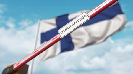 finland : Closing boom barrier with QUARANTINE sign against the Finnish flag. Border closure or infection related isolation in Finland Stock Footage