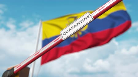 охрана : Barrier gate with QUARANTINE sign being closed with flag of Ecuador as a background. Ecuadorian border closure or infection related isolation