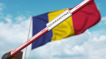 regulamin : Closed boom gate with QUARANTINE sign on the Romanian flag background. Border closure or infection related isolation in Romania