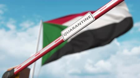 barrier gate : Closed boom gate with QUARANTINE sign on the Sudanian flag background. Restricted border crossing or infection related isolation in Sudan