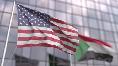 official : Waving flags of the USA and Sudan in front of a modern skyscraper Stock Footage