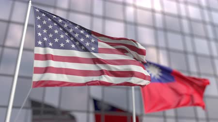 official : Waving flags of the United States and Taiwan in front of a modern skyscraper facade