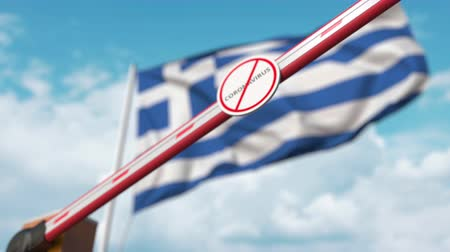 zakaz : Closed boom gate with STOP CORONAVIRUS sign on the Greek flag background. Quarantine in Greece