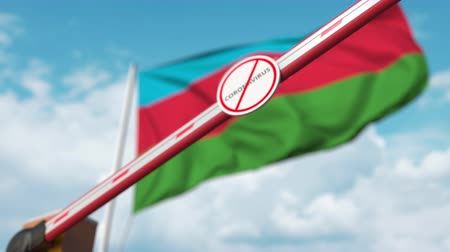 zákaz : Closing boom barrier with STOP CORONAVIRUS sign against the Azerbaijani flag. Quarantine in Azerbaijan Dostupné videozáznamy