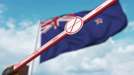 nowa zelandia : Closing boom barrier with STOP CORONAVIRUS sign against the New Zealand flag. Quarantine in New Zealand