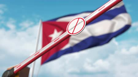 zakaz : Closing boom barrier with STOP CORONAVIRUS sign against the Cuban flag. Quarantine in Cuba Wideo