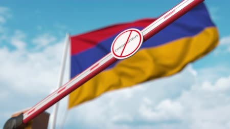 zakaz : Barrier gate with STOP CORONAVIRUS sign being closed with flag of Armenia as a background. Armenian Quarantine