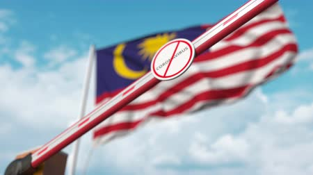 malásia : Barrier gate with STOP CORONAVIRUS sign being closed with flag of Malaysia as a background. Malaysian quarantine