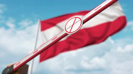 barriers : Closed boom gate with STOP CORONAVIRUS sign on the Austrian flag background. Quarantine in Austria Stock Footage
