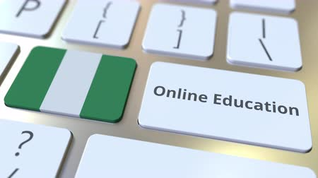 nigeria flag : Online Education text and flag of Nigeria on the buttons on the computer keyboard. Modern professional training related conceptual 3D animation Stock Footage