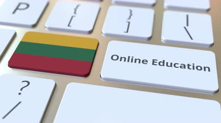 litvanya : Online Education text and flag of Lithuania on the buttons on the computer keyboard. Modern professional training related conceptual 3D animation Stok Video