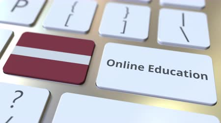 mais alto : Online Education text and flag of Latvia on the buttons on the computer keyboard. Modern professional training related conceptual 3D animation
