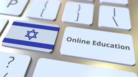 izrael : Online Education text and flag of Israel on the buttons on the computer keyboard. Modern professional training related conceptual 3D animation Stock mozgókép