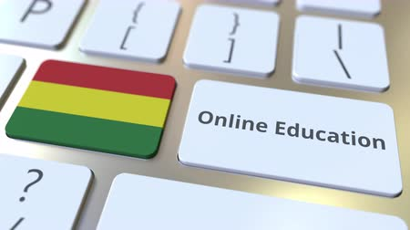 empregos : Online Education text and flag of Bolivia on the buttons on the computer keyboard. Modern professional training related conceptual 3D animation Stock Footage