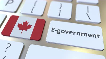 involvement : E-government or Electronic Government text and flag of Canada on the keyboard. Modern public services related conceptual 3D animation