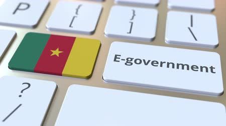 involvement : E-government or Electronic Government text and flag of Cameroon on the keyboard. Modern public services related conceptual 3D animation